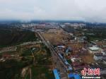 图为甘肃省庆阳市合水县棚户区改造项目所在地的航拍图。 杨艳敏 摄 - 甘肃新闻