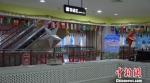 丝绸之路敦煌国际特色馆已引进生产厂商68家,入驻企业5家,年销售额达到368万元,为目前甘肃最大的O2O文化旅游购物体验馆。 李亚龙 摄子商务产业基地。 李亚龙 摄 - 甘肃新闻