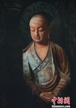 """图为用中国非遗苏绣""""绣""""出的敦煌石窟造像。 钟欣 摄 - 甘肃新闻"""