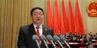 1月26日,甘肃省高级人民法院院长梁明远向甘肃省第十三届人民代表大会第一次会议作《甘肃省高级人民法院工作报告》。 韦德占 摄 - 甘肃新闻