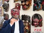 图为展示傩面具。 刘薛梅 摄 - 甘肃新闻
