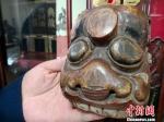 图为收藏的傩面具。 刘薛梅 摄 - 甘肃新闻