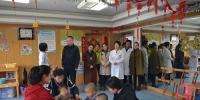 1参观中心儿童康复科.jpg - 残疾人联合会