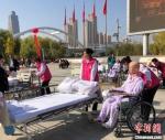 图为居家养老护理比赛项目。(资料图) 徐雪 摄 - 甘肃新闻