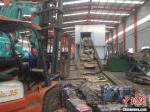 图为报废汽车拆解生产线。(资料图) 杜萍 摄 - 甘肃新闻