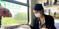 """来一起""""虚度时光""""中国首家绿皮慢火车书店开业 - 人民网"""